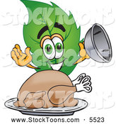 Stock Cartoon of a Eco Friendly Leaf Mascot Cartoon Character Serving a Thanksgiving Turkey on a Platter by Toons4Biz